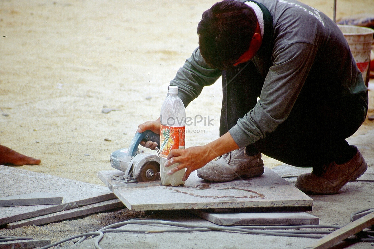 A Worker Who Grind Ceramic Tiles Photo Imagepicture Free Download