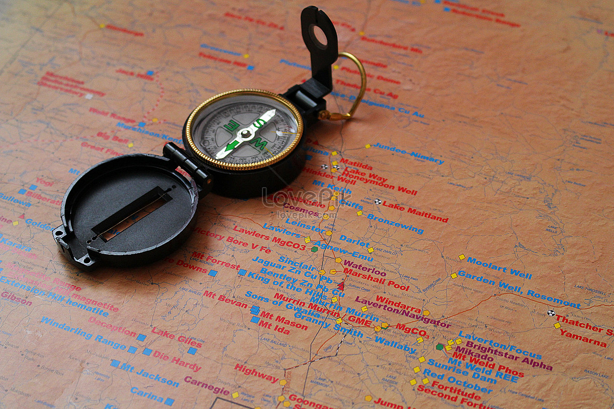 A compass on a map photo image_picture free download