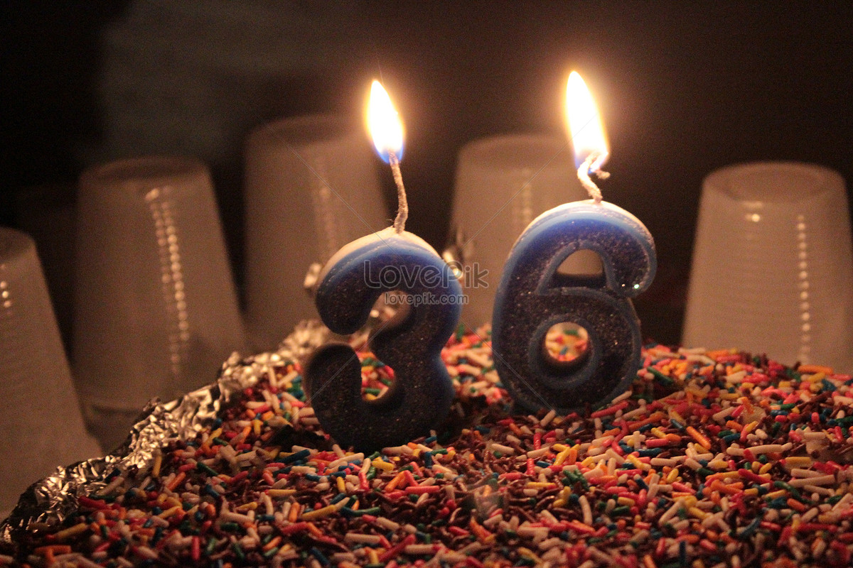 A Candle On A Birthday Cake Photo Imagepicture Free Download