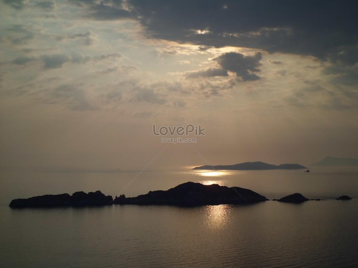 Pemandangan Laut Pada Waktu Senja Gambar Unduh Gratisimej