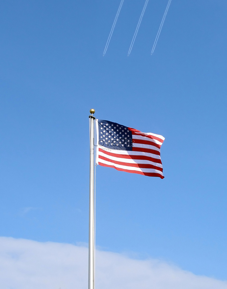 a photograph of the american flag flying as a jet photo