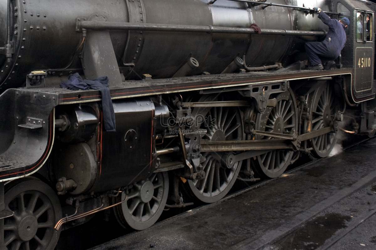 A person working on a steam engine photo image_picture free download ...