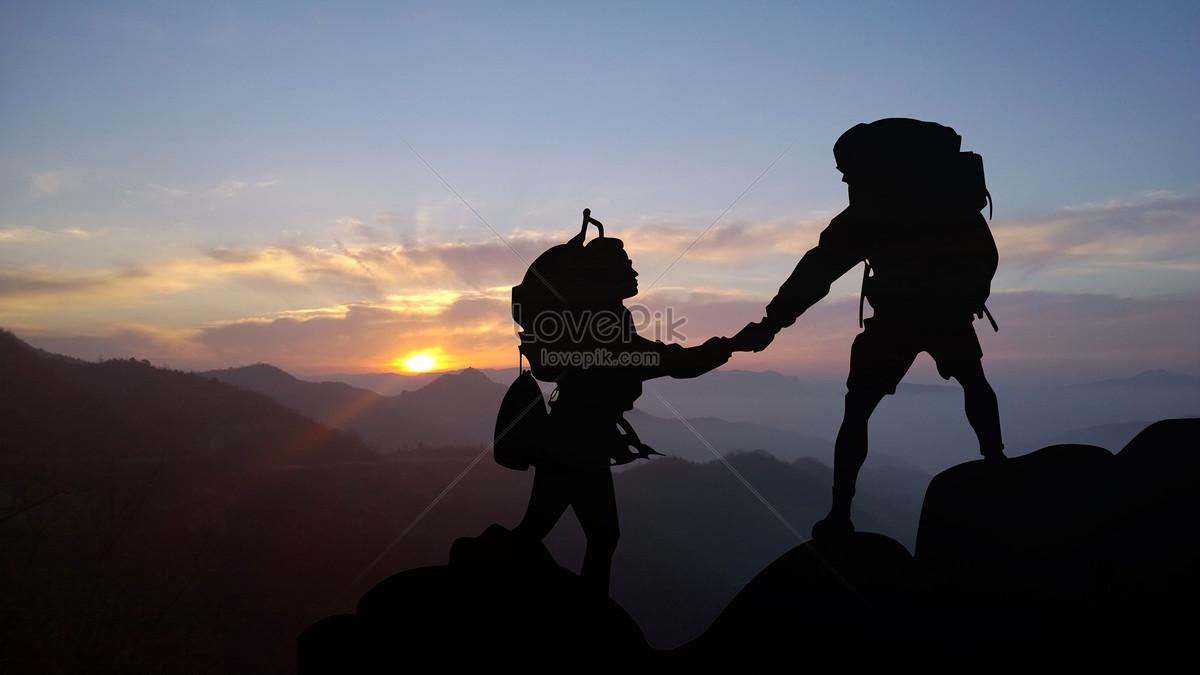 統一と協力の登山シルエット