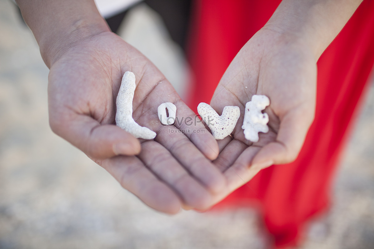 Valentines Day Lovers Put Love In Their Hands To Express Love Photo