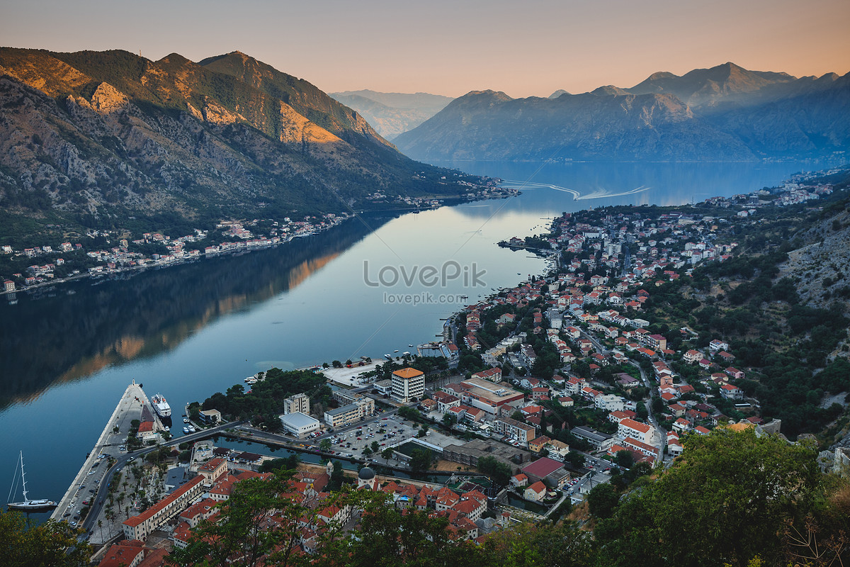 the famous tourist city of kotor city sunrise photo image picture