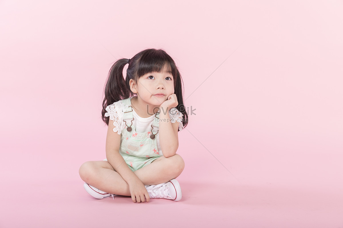 Little Girl Thinking About Her Cheeks Photo Image Picture Free