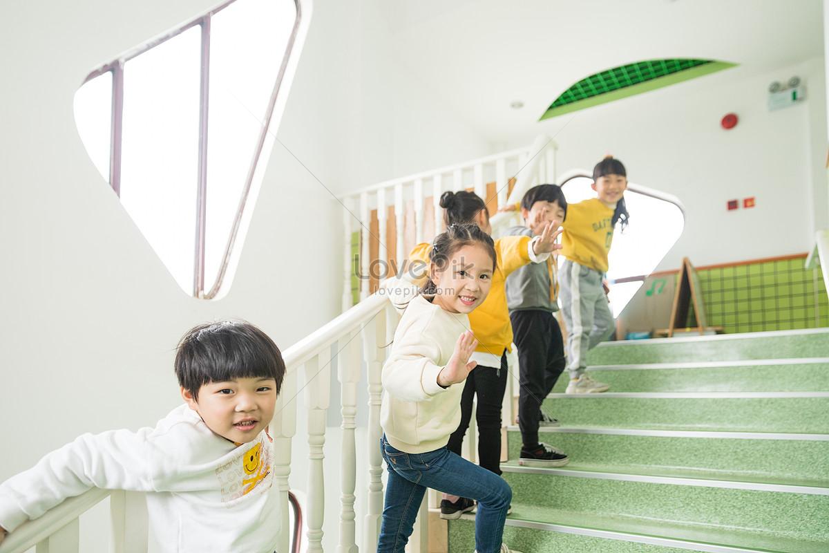 Kindergarten children go up stairs photo image_picture free.